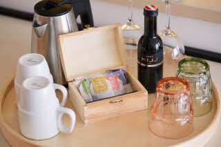 coffee, tea and wine station in room at scandic berlin potsdamer platz in germany