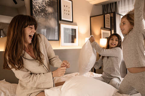 family in bed at scandic hotels