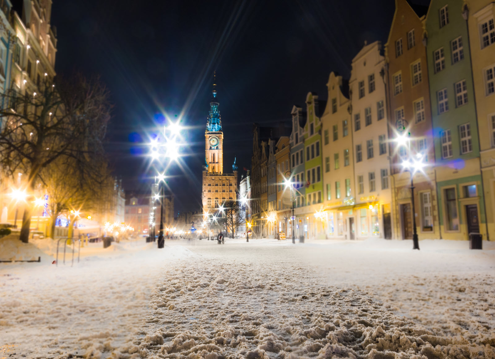 Town Hall of the Main City (Polish: Ratusz) in Gdansk Danzig Poland Europe, built in Gothic and Renaissance architectural styles. Long Street Market. Winter snow night scenery