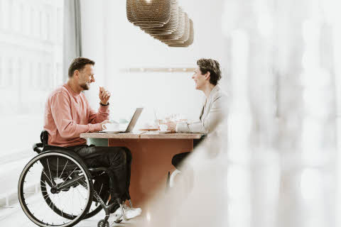 ma_ in_a_wheelchair_with _a_women