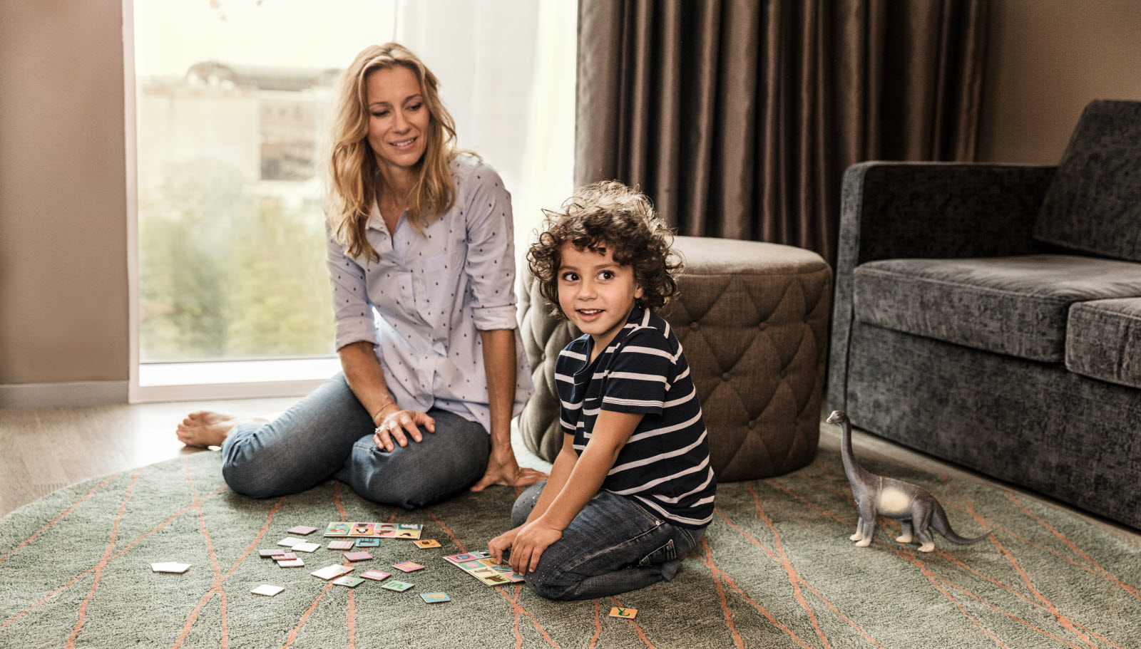 Mother and child sitting on the floor