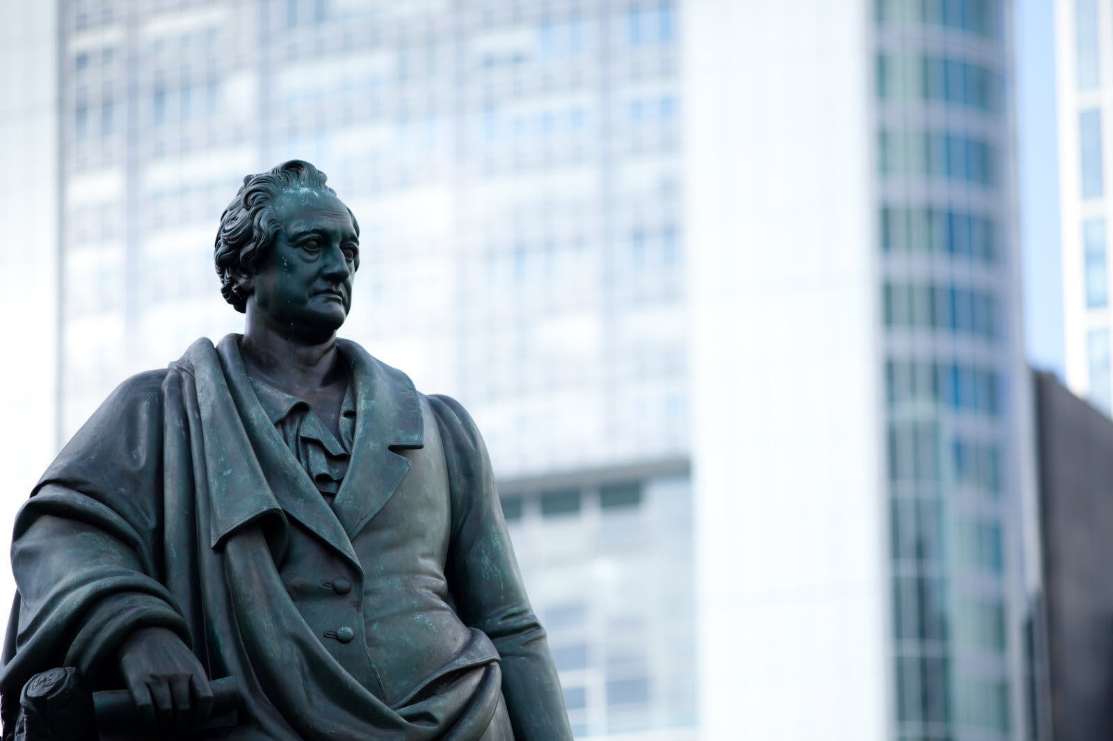Goethe statue at Goetheplatz in Frankfurt with skyscraper