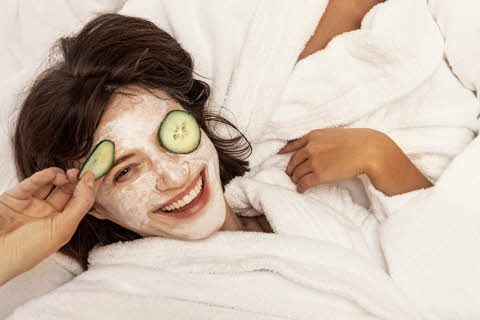 friends with facemask in bed at scandic hotels