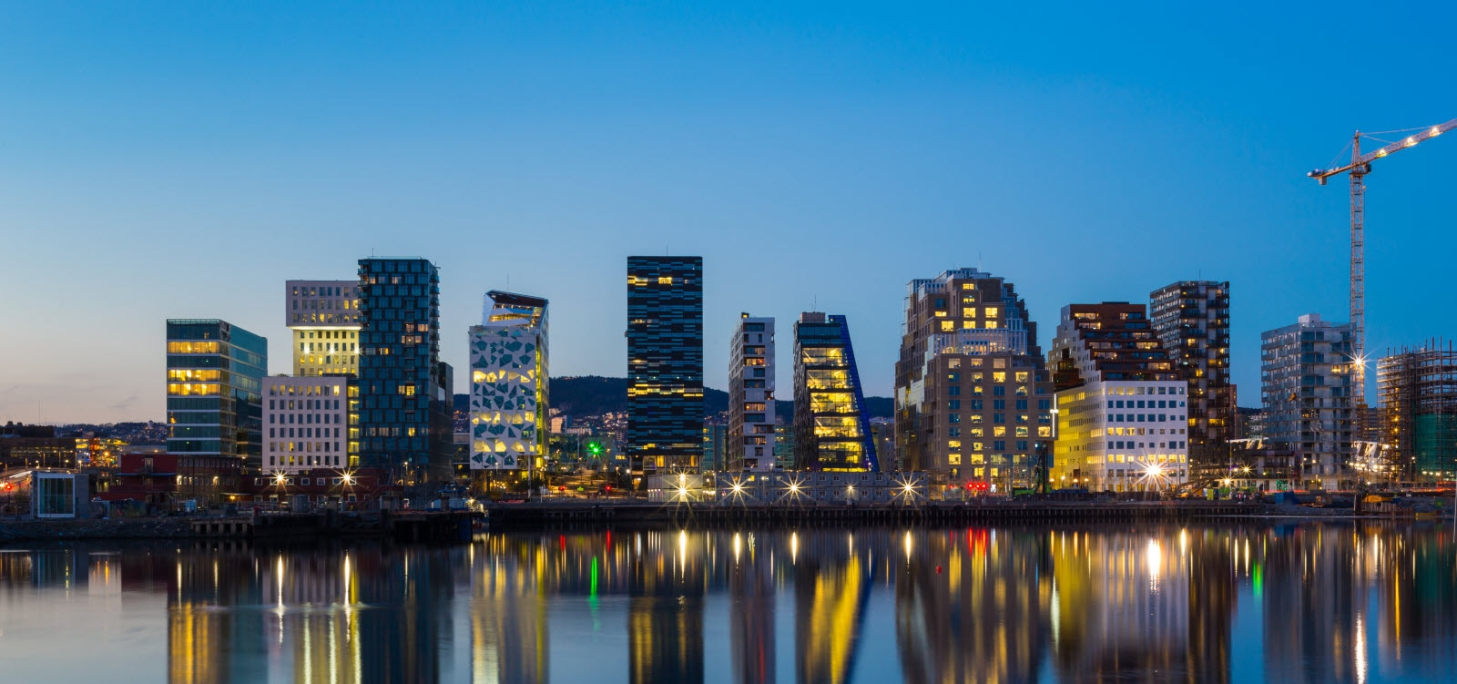13004519-modern-buildings-in-oslo-at-twilight_by_W.jpg