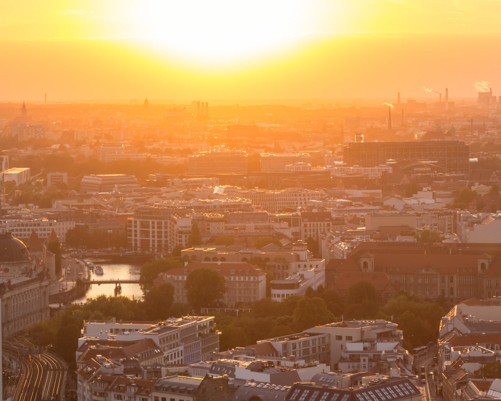 Beautiful panoramic aerial view over Berlin, Germany, in romantic colorful sunset.