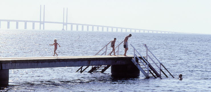 Kids can swim at Amager Strandpark with Oresund Bridge in the background