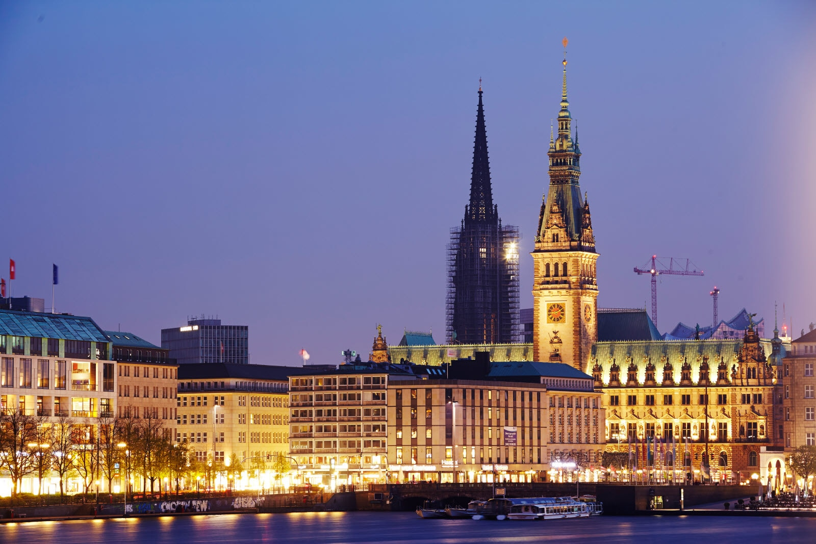The picture shows the Inner Alster of Hamburg and the town hall taken in the evening..